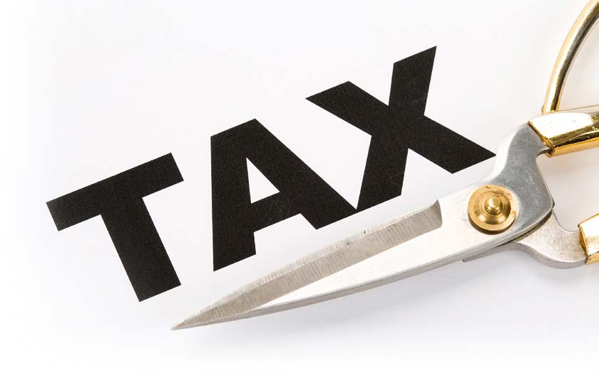 Photo of scissors under the word Tax
